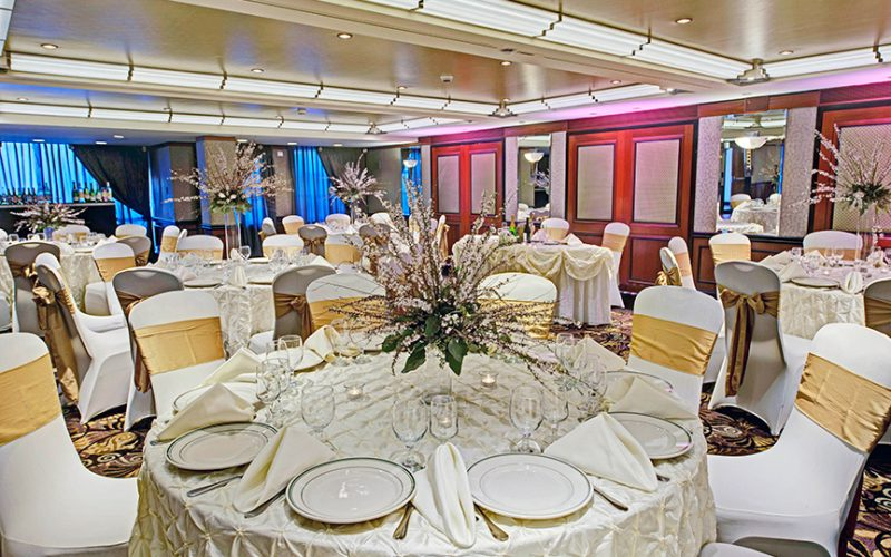 elegant dining area with dinner tables and chairs