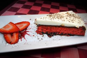 Red velvet cake with white cream frosting